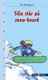 Silje står på snow-board