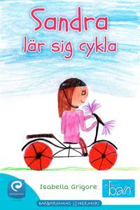 Sandra lär sig cykla