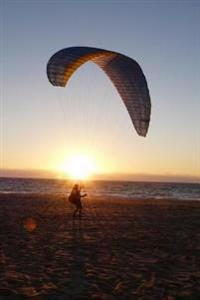 Paraglider on the Beach at Sunset Journal: 150 Page Lined Notebook/Diary